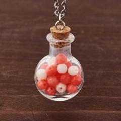 Кулон коралл белый, розовый Индонезия (биж. сплав, стекло) бутылочка огранка 3 см